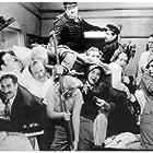 Groucho Marx, Marion Bell, Edna Bennett, Allan Jones, Jack 'Tiny' Lipson, Chico Marx, Harpo Marx, Inez Palange, Stephen Soldi, Harry 'Zoup' Welsh, and Frank Yaconelli in A Night at the Opera (1935)