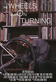 The Wheels Keep on Turning Poster