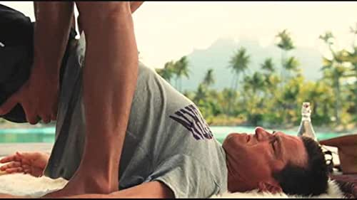 "Couples Retreat: ""Salvadore helps stretch Jason and Shane during yoga"""