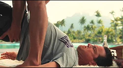 "Couples Retreat: ""Salvadore helps stretch Jason and Shane during yoga"""