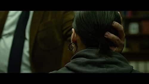 Journalist Mikael Blomkvist (Craig) is aided in his search for a woman who has been missing for forty years by Lisbeth Salander (Mara), a young computer hacker.