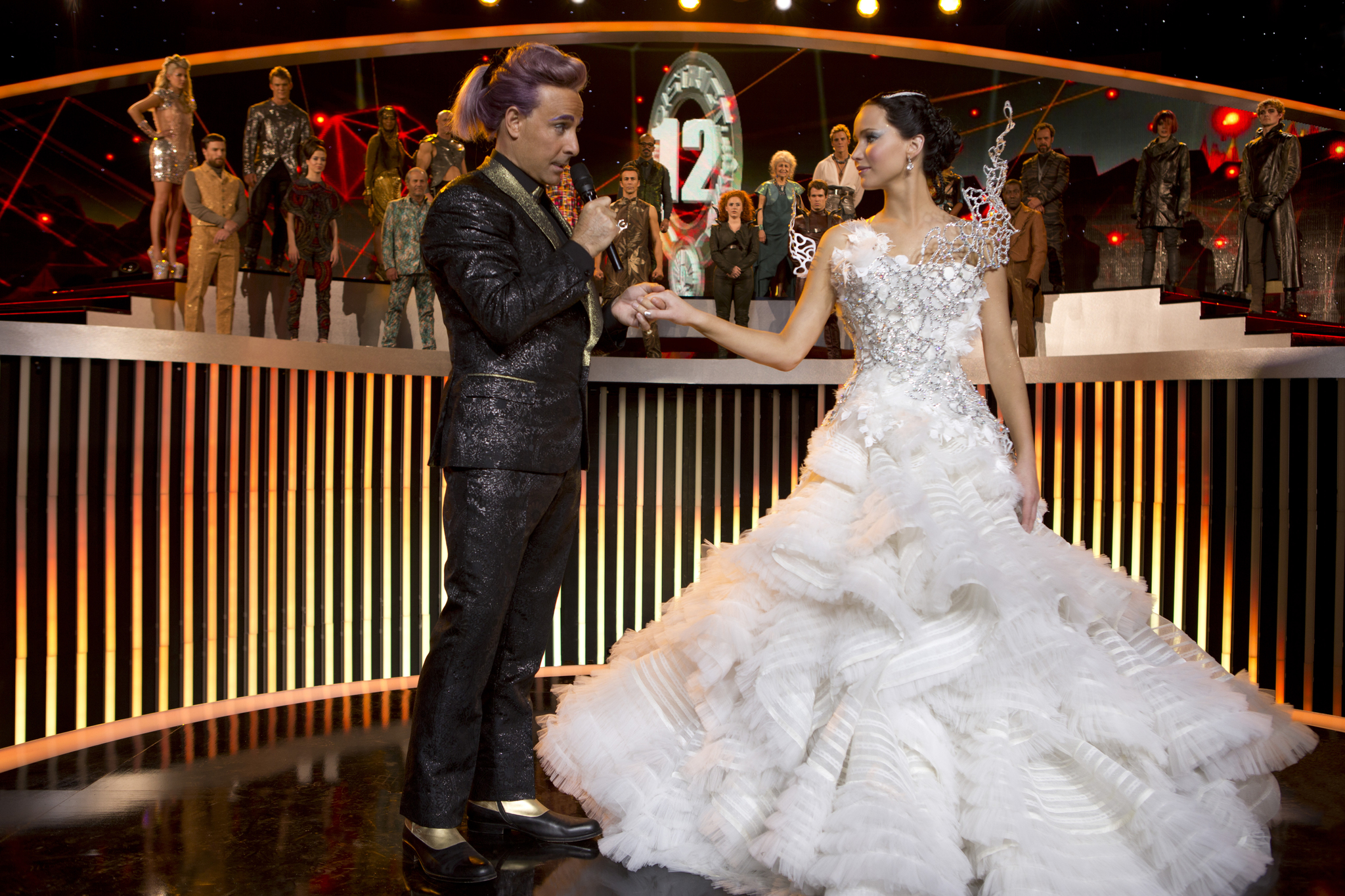 Stanley Tucci, Lynn Cohen, Bruno Gunn, Meta Golding, Megan Hayes, E. Roger Mitchell, Alan Ritchson, Stephanie Leigh Schlund, Jennifer Lawrence, and Sam Claflin in The Hunger Games: Catching Fire (2013)