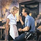 Nicolas Cage and Bridget Fonda in It Could Happen to You (1994)