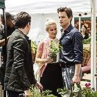 Matt Bomer and Laura Ramsey in White Collar (2009)