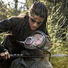 Toby Levins and Marie Avgeropoulos in The 100 (2014)