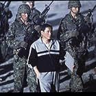 Takeshi Kitano in Batoru rowaiaru (2000)