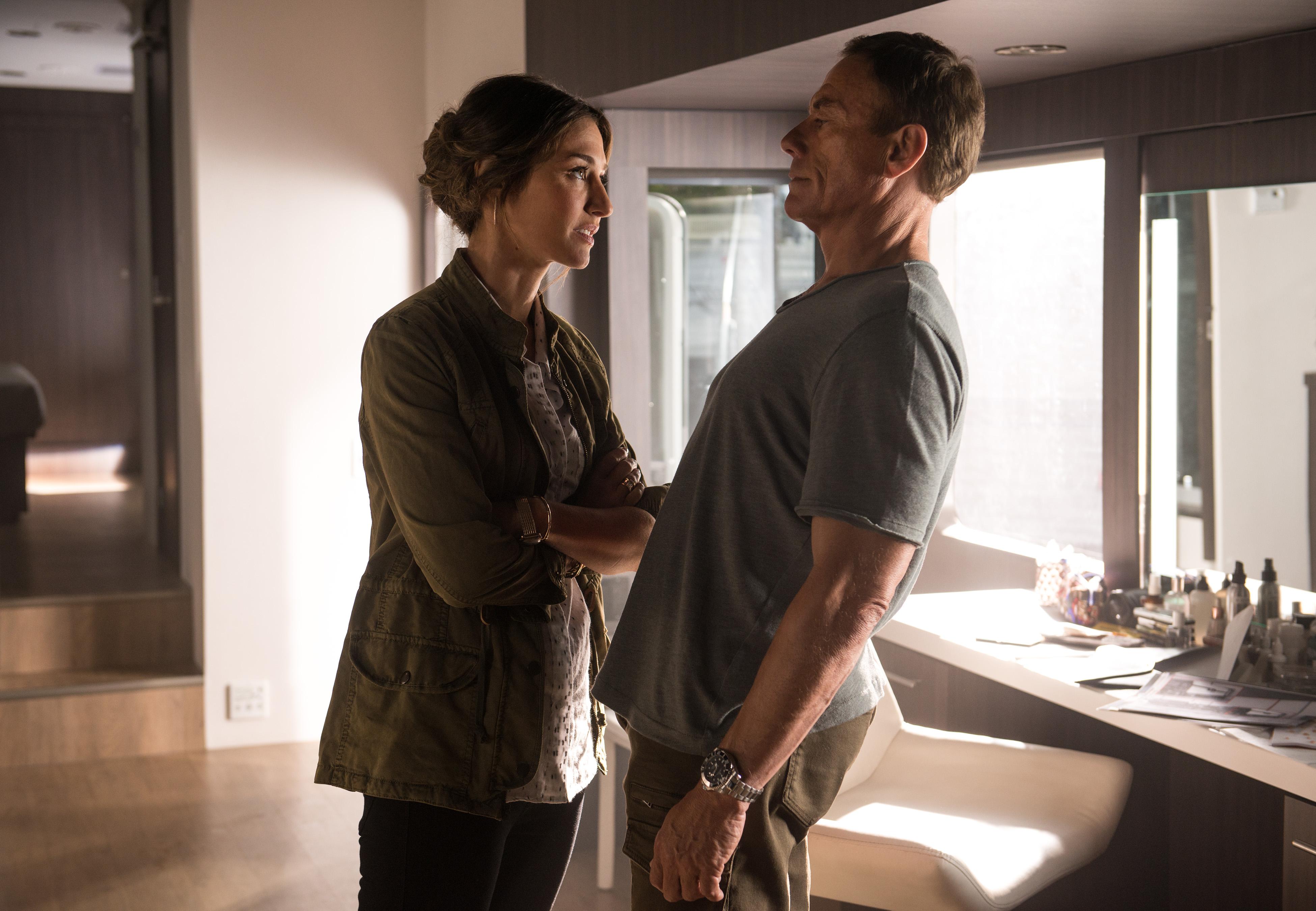 Jean-Claude Van Damme and Kat Foster in Pilot (2016)