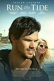 Taylor Lautner and Johanna Braddy in Run the Tide (2016)