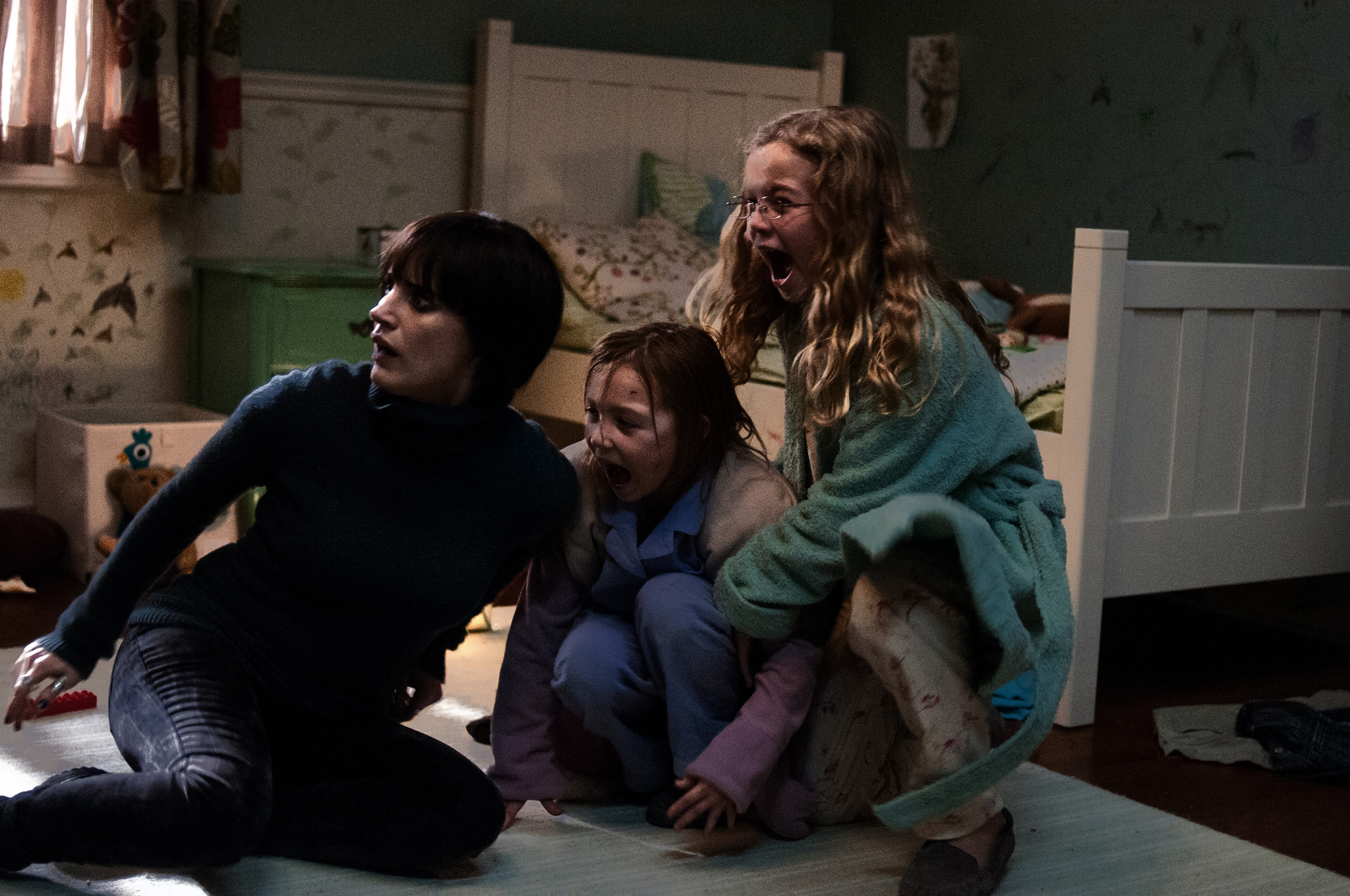 Jessica Chastain, Megan Charpentier, and Isabelle Nélisse in Mama (2013)