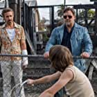 Russell Crowe, Ryan Gosling, and Lance Valentine Butler in The Nice Guys (2016)