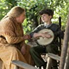 """Kathleen Turner and Tyler Crumley in """"These Old Bones,"""" an episode from """"Dolly Parton's Heartstrings."""