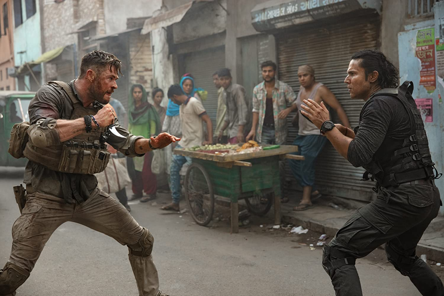 Randeep Hooda and Chris Hemsworth in Extraction (2020)