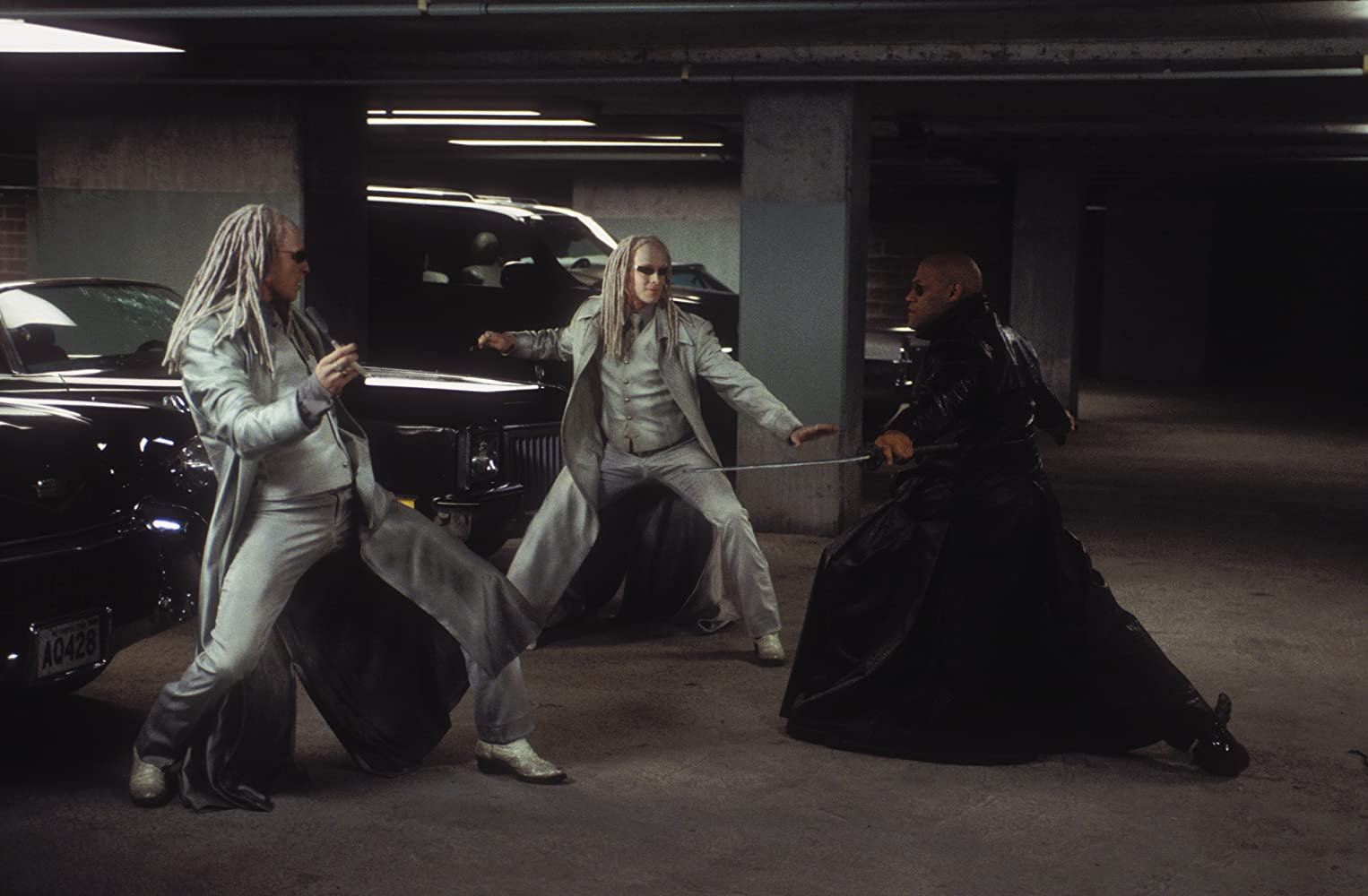 Laurence Fishburne, Adrian Rayment, and Neil Rayment in The Matrix Reloaded (2003)