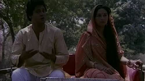 Shankar's marriage is arranged. Only during the ceremony does he realise that his bride, Gouri, is the girl he had set eyes on in the mela where he had seen her with her grandmother. The wedding night! Innocent Gouri wants to know what Shankar is doing in her bedroom? Frustrated, Shanker spends the first night, and subsequent nights, sleeping on an uncomfortable sofa. Gouri goes to visit her parents, yet untouched, unspoiled, Shanker pours his heart out in his letters to her but they are ignored. Gouri returns, and flies into a rage when she discovers Shanker has opened a letter addressed to her. What right has he to do so? What right, asks Shankar? A husband has no right? He tries to forcibly embrace her, she screams, pushes him aside, calls him a brute. Her innocence still unscathed. Gouri goes to attend her friend Radha's wedding where she realises that women change with marriage. She feels the compelling urge to return home, to Shanker,her husband. Overnight, she transforms into a dutiful daughter-in-law, a responsible wife, only to discover that Shanker is not there.She comes to know that he has left for his college hostel during Gouri's absence. Months pass without any news or letter from him. Its mela time again and Shankar comes back to the spot where he had first seen Gouri. He meets Radha and her husband, but where is Gouri? Gouri, is keeping a vigil for the man she loves, the man, whom she so ardently desires. Shankar comes home to fall into her embrace, to his wife who, at last, has awakened.