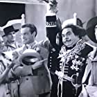 Bob Hope, Jules Epailly, and Leah Ray in Going Spanish (1934)