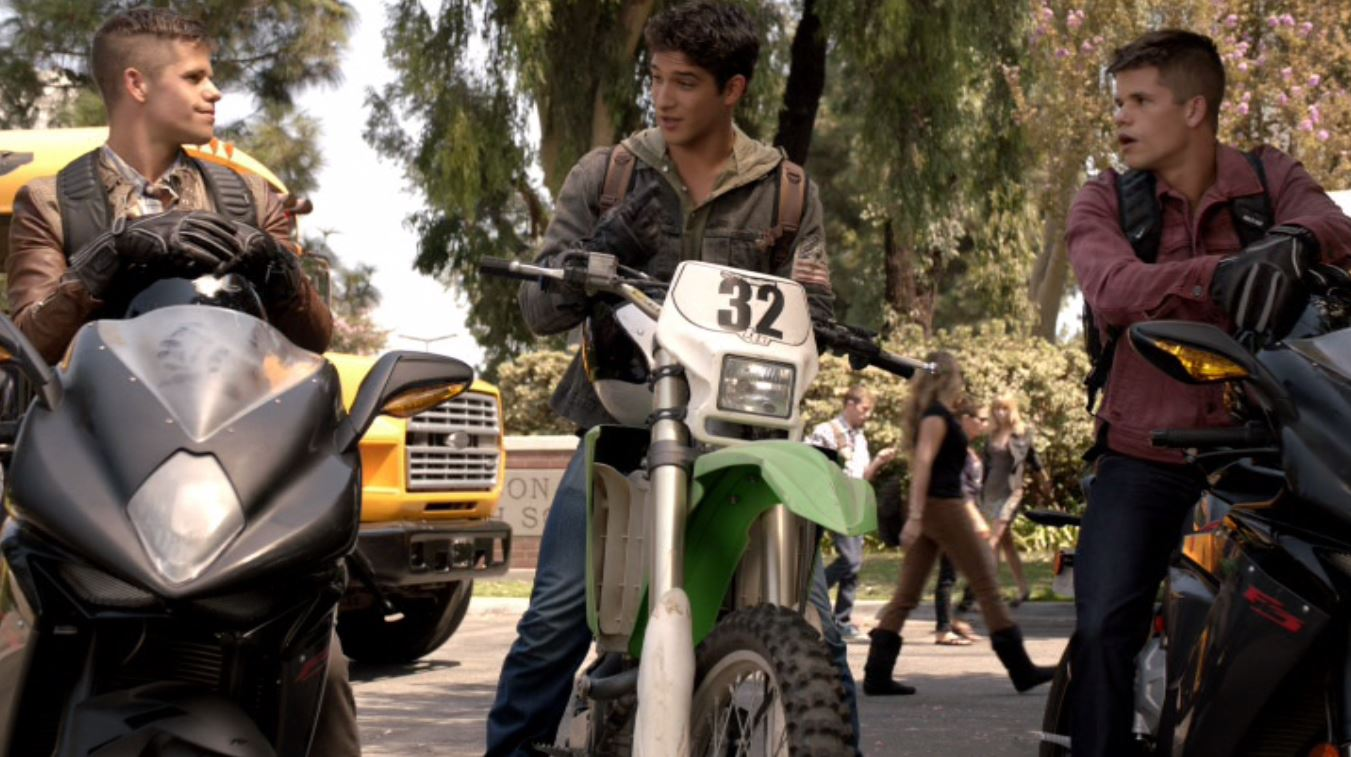Tyler Posey, Charlie Carver, and Max Carver in Teen Wolf (2011)