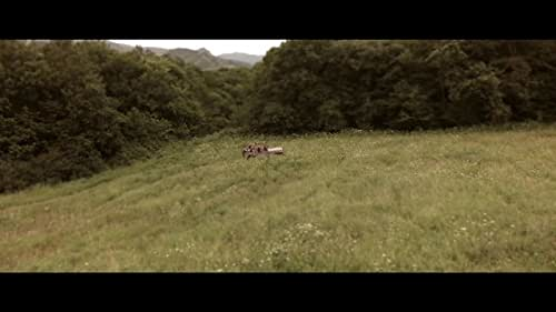 Trapped on top of an armed landmine, an American tourist and his girlfriend are terrorized by a hunter and his dog.