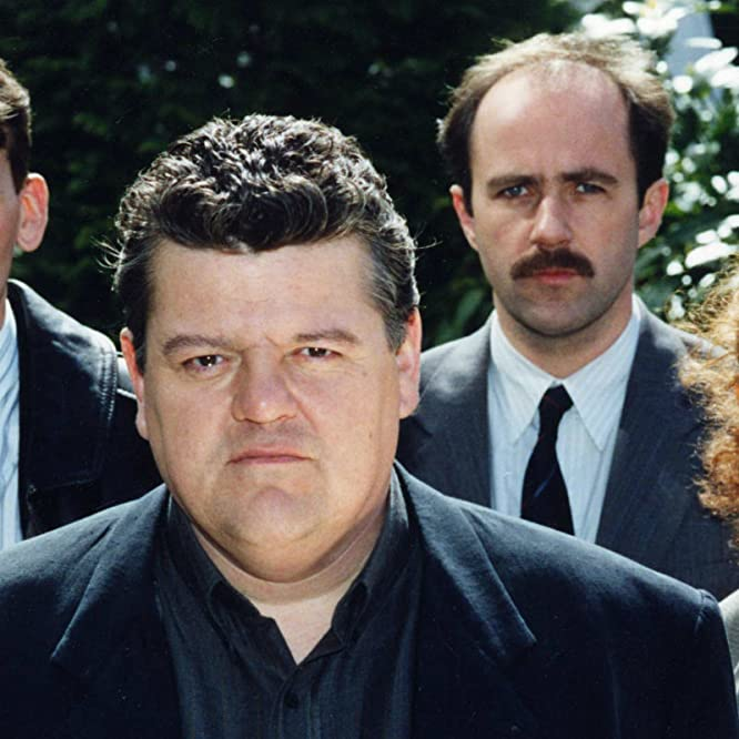 Robbie Coltrane, Christopher Eccleston, Lorcan Cranitch, and Geraldine Somerville in Cracker (1993)