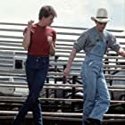 Kevin Bacon and Chris Penn in Footloose (1984)