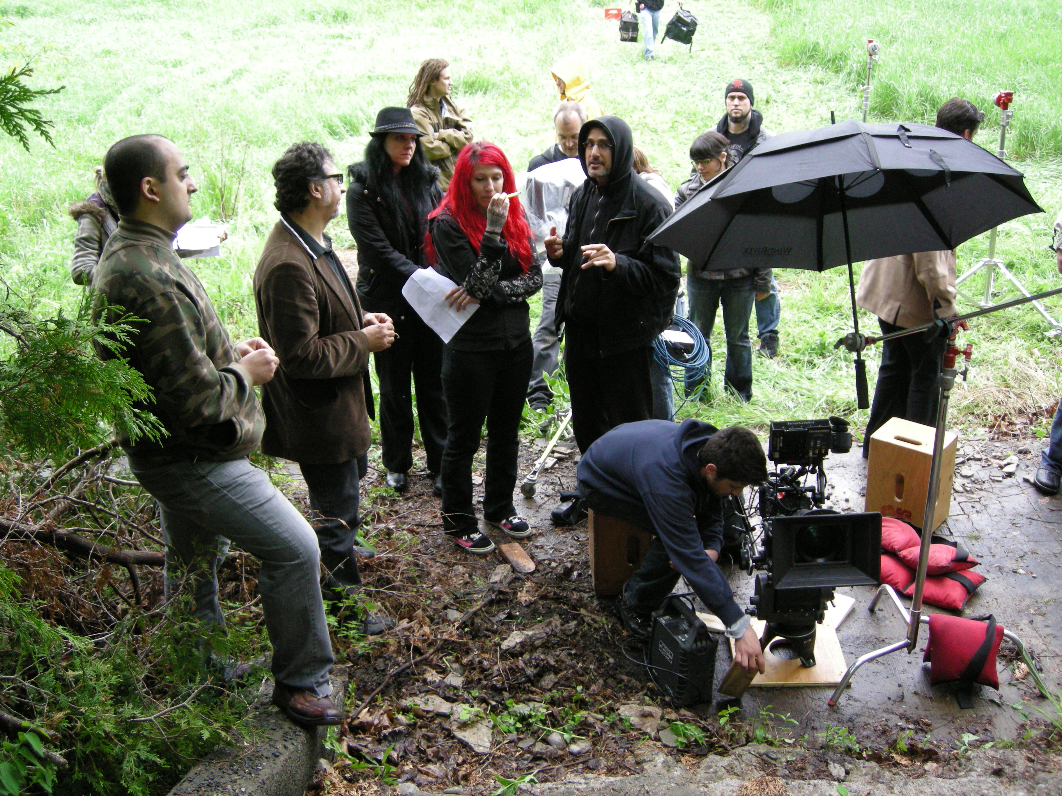 With cinematographer Karim Hussain on the set of The Captured Bird (2012).