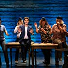Astrid Van Wieren, Petrina Bromley, Jenn Colella, Emily Walton, Sharon Wheatley, and Q. Smith in Come from Away (2021)