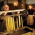 Lesley Manville and Sylvester McCoy in The Christmas Candle (2013)