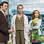 Noah Wyle, Rebecca Romijn, and Lindy Booth in The Librarians (2013)