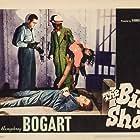 Humphrey Bogart, William Edmunds, and Richard Travis in The Big Shot (1942)