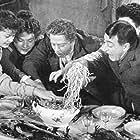 Liana Billi, Valeria Moriconi, Dolores Palumbo, Totò, and Enzo Turco in Miseria e nobiltà (1954)