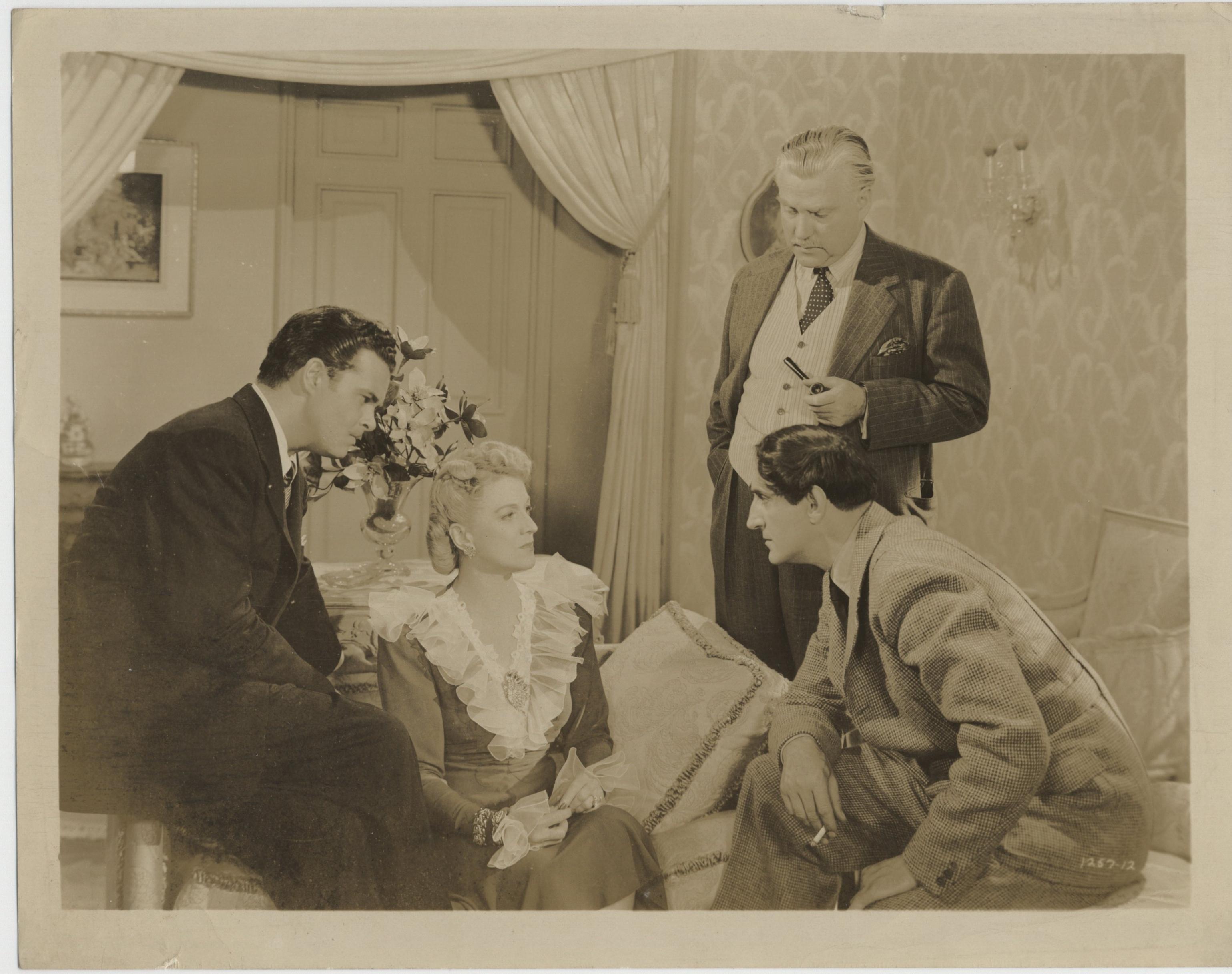 Basil Rathbone, Nigel Bruce, Edmund MacDonald, and Regina Wallace in Sherlock Holmes in Washington (1943)