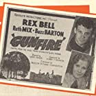 Rex Bell and Ruth Mix in Gunfire (1934)