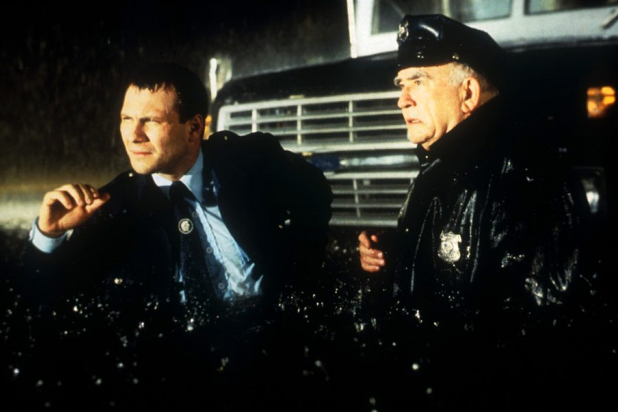 Christian Slater and Edward Asner in Hard Rain (1998)