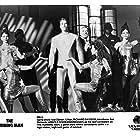 Arnold Schwarzenegger, Richard Dawson, Karen Owens, and Mia Togo in The Running Man (1987)