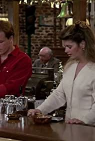 Kirstie Alley and Woody Harrelson in Cheers (1982)