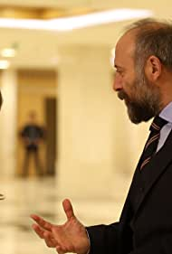 Halit Ergenç and Asli Enver in Babil (2020)