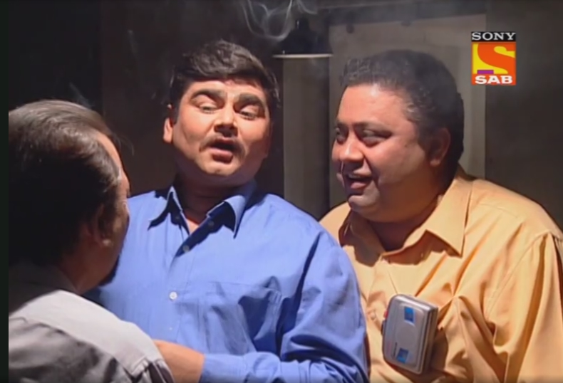 Deven Bhojani and Manoj Pahwa in Office Office (2000)