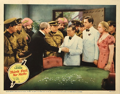 Peter Lorre, Thomas Beck, Virginia Field, and Murray Kinnell in Think Fast, Mr. Moto (1937)