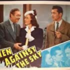 Wendy Barrie, Richard Dix, Edmund Lowe, and Kent Taylor in Men Against the Sky (1940)