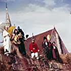 Geneviève Bujold, Pierre Brasseur, Jean-Claude Brialy, Françoise Christophe, Julien Guiomar, Micheline Presle, and Michel Serrault in Le roi de coeur (1966)