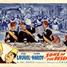 Oliver Hardy, Charita Alden, Charley Chase, Marvin Hatley, Suzanna Kim, Stan Laurel, Ty Parvis, and Marta DeVeaux in Sons of the Desert (1933)