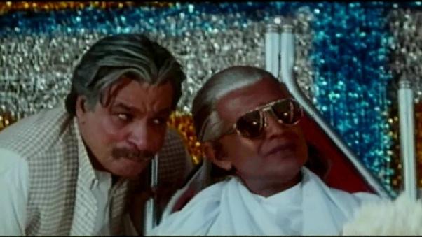 Mithun Chakraborty and Kader Khan in Jallaad (1995)