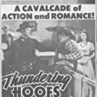 Frank Ellis, Tim Holt, and Luana Walters in Thundering Hoofs (1942)