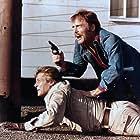 Roger Moore and Stacy Keach in Gli esecutori (1976)