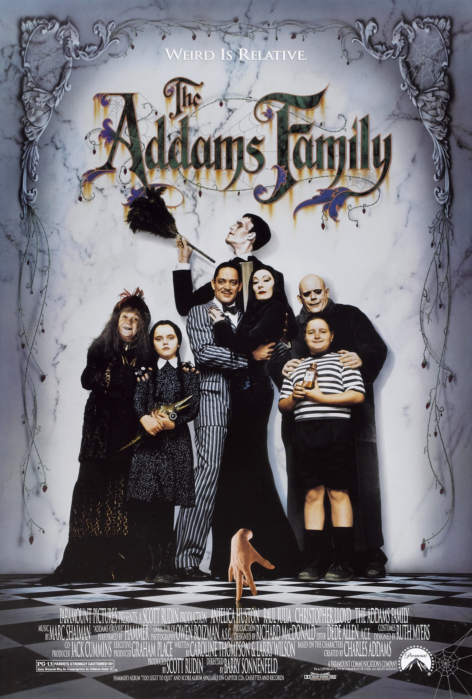 Christina Ricci, Raul Julia, Christopher Lloyd, Anjelica Huston, Christopher Hart, Judith Malina, Carel Struycken, and Jimmy Workman in The Addams Family (1991)