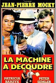 Jean-Pierre Mocky, Patricia Barzyk, and Pierre Semmler in La machine à découdre (1986)