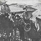 Cliff Edwards and Preston Foster in American Empire (1942)