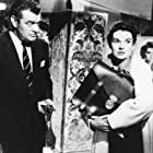 Dianne Foster and Jack Hawkins in Gideon's Day (1958)