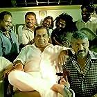 Brahmanandam, Upendra, Sampath Raj, and Joy Badlani in S/O Satyamurthy (2015)