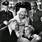 Joan Blondell, C. Henry Gordon, Ruth Hall, Bruce Mitchell, and John Wray in Miss Pinkerton (1932)