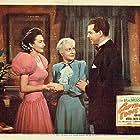 Lynn Bari, Fred MacMurray, and Mary Philips in Captain Eddie (1945)